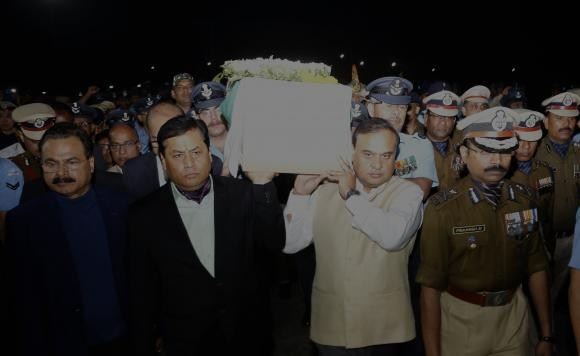 Assam Chief Minister Sarbananda Sonowal  and Assam Finance Minister Dr. Himanta Biswa Sarma shouldering the coffin of slain CRPF